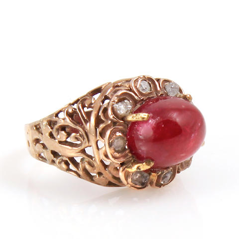 A ruby cabochon, diamond and yellow metal ring