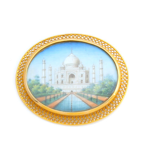"An enamel and gold ""taj mahal"" brooch"