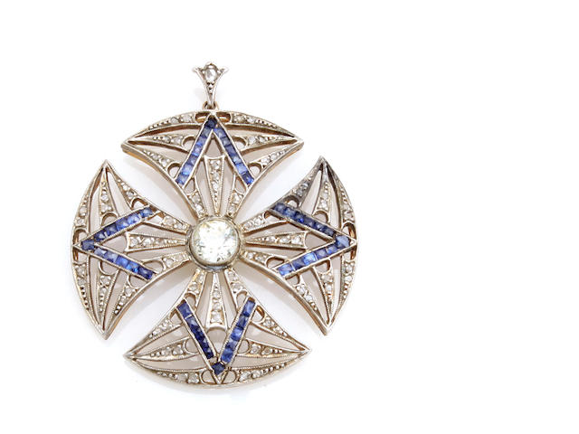A diamond, sapphire and silver-topped 14k gold pendant
