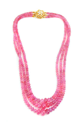 A ruby bead, diamond and 18k gold triple strand necklace