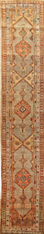 A Serab runner  Northwest Persia size approximately 3ft. 1in. x 15ft. 8in.