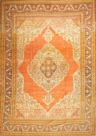 A Tabriz carpet  Northwest Persia size approximately 9ft. 4in. x 13ft. 2in.