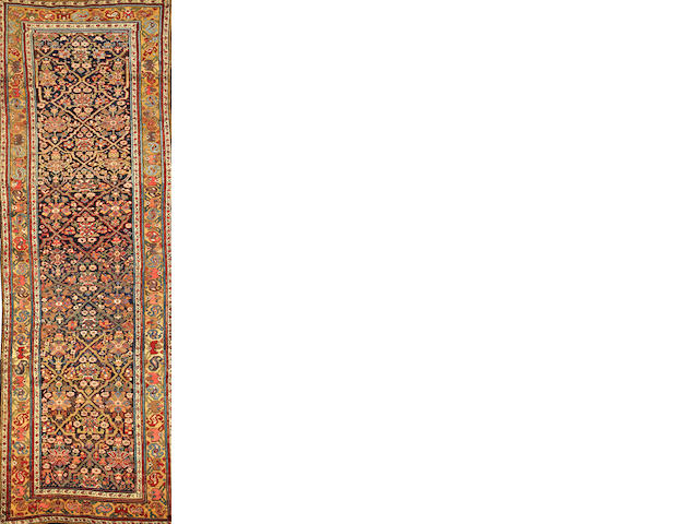 A Northwest Persian runner  Northwest Persia size approximately 4ft. 1in. x 12ft. 3in.