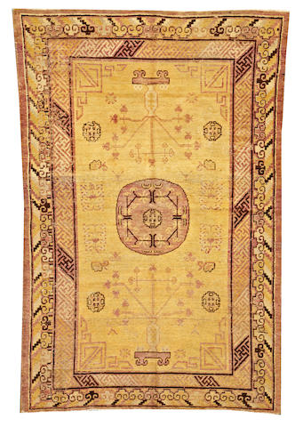 A Khotan rug  Turkestan size approximately 4ft. 8in. x 7ft. 1in.