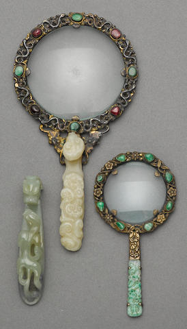 A group of three jade decorations, including one belt hook and two jade mounted magnifying glasses