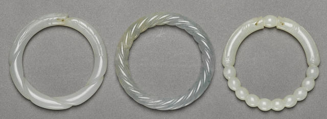 A group of three jade bangles
