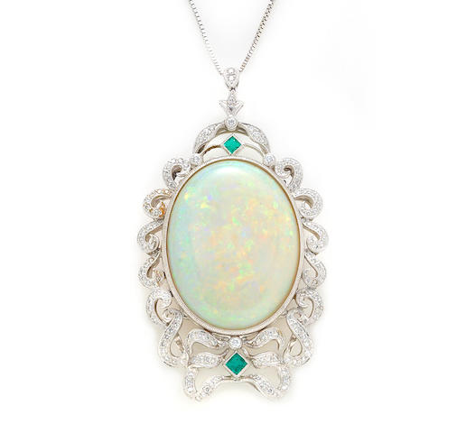 An oval opal, round brilliant cut diamond, emerald and platinum pendant, Sophia D With 14 karat white gold chain.