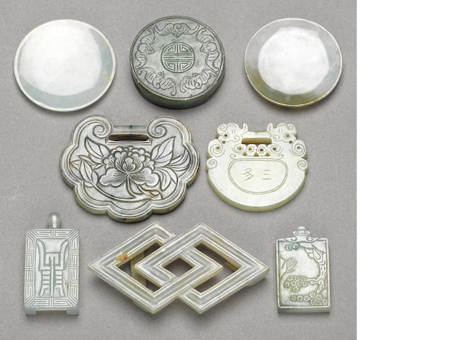 A group of eight jadeite decorations