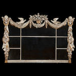 An Italian Baroque style silvered and gilt wood over mantle mirror <BR />early 20th century