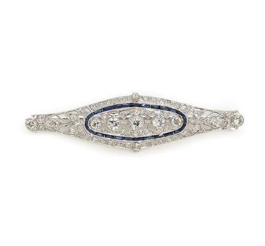 An art deco diamond, sapphire and platinum brooch. circa 1930