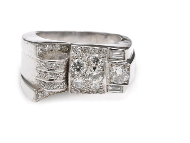 A diamond and platinum bow motif ring (0.65ct.)