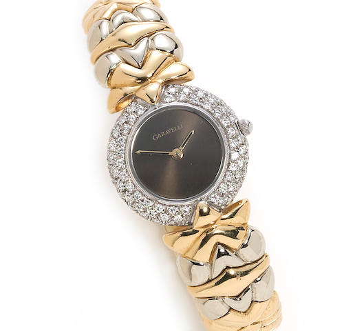 A diamond and eighteen karat bicolor gold flexible bangle bracelet wristwatch, Garavelli
