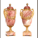 A pair of Neoclassical style gilt bronze mounted marble cassolettes