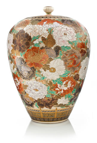 A Satsuma covered vase by Yabu Meizan decorated with peony blossoms. Height 13.25 inches