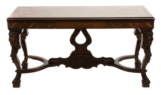 A Renaissance style parcel gilt inlaid rosewood center table
