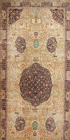 A Tabriz carpet  Northwest Persia size approximately 9ft. 8in. x 22ft. 10in.