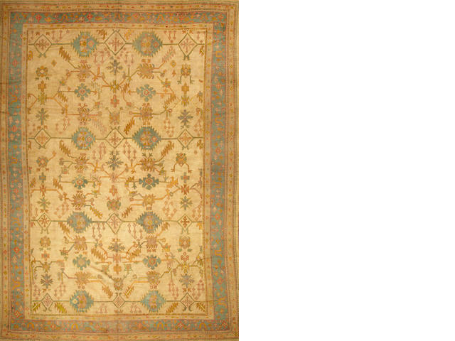 An Oushak carpet West Anatolia size approximately 12ft. x 17ft. 6in.