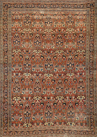 A Meshed rug Northeast Persia size approximately 5ft. x 7ft. 1in.