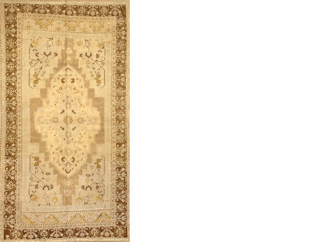 A Turkish carpet  Turkey size approximately 6ft. 10in. x 12ft. 8in.