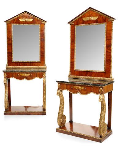 A pair of Northern European Neoclassical parcel gilt mahogany 'Retour d'Egypte' console tables and mirrors   first quarter 19th century