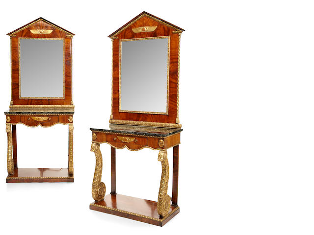 "A pair of parcel gilt mahogany Empire ""retour d'Egypte"" console tables and mirrors <BR /> first quarter 19th century"