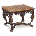 An Italian Renaissance style oak and walnut table <BR /> top early 18th century, base 19th century