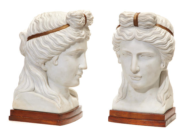 A pair of Neoclassical style parcel gilt white marble busts of Greek women