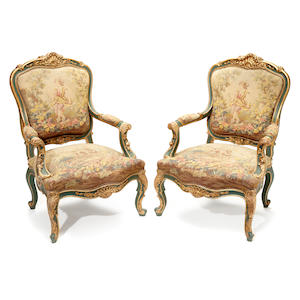 A pair of Italian Rococo style parcel gilt green painted armchairs .  late 19th century
