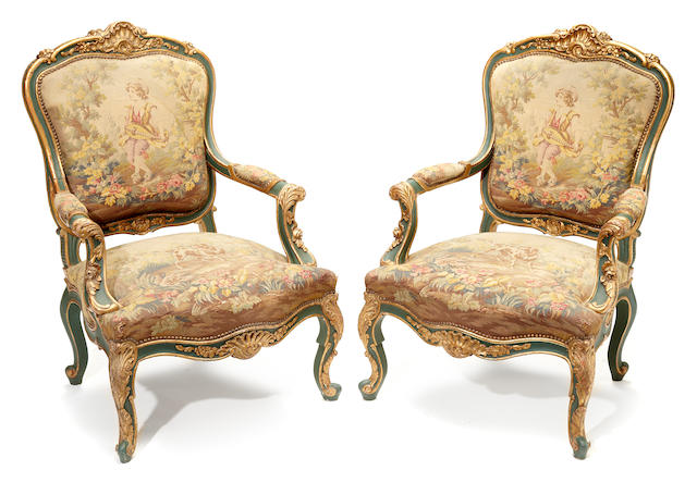 A pair of Italian Rococo style parcel gilt green painted armchairs <BR /> late 19th century