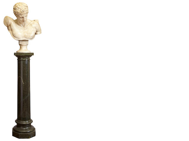 A carved white marble of a Greek youth on a Neoclassical style green marble pedestal