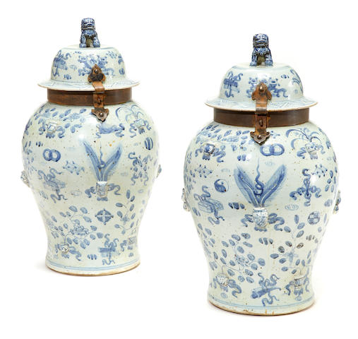 A pair of Chinese blue and white porcelain urns with patinated metal mounts late 20th century