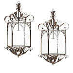 A pair of Renaissance style iron, tole and etched glass lanterns