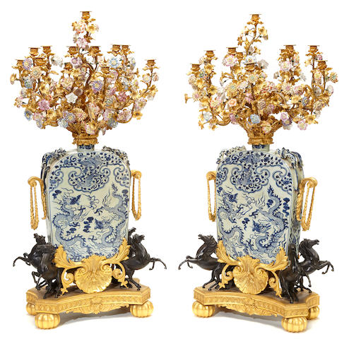 A pair of Chinese blue and white porcelain jars with Louis XV style gilt, patinated bronze and porcelain flower mounted twenty-four light candelabra