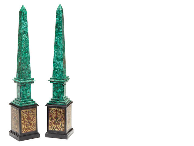 A pair of Napoleon III style malachite veneered obelisks on ebonized and boulle marquetry plinths