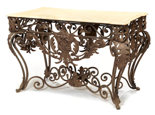 A Rococo style iron, tole and marble center table