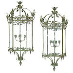 A pair of Neoclassical style patinated bronze and etched glass lanterns