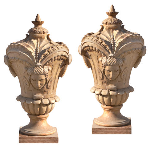 A good pair of Rococo style tan marble gate finials