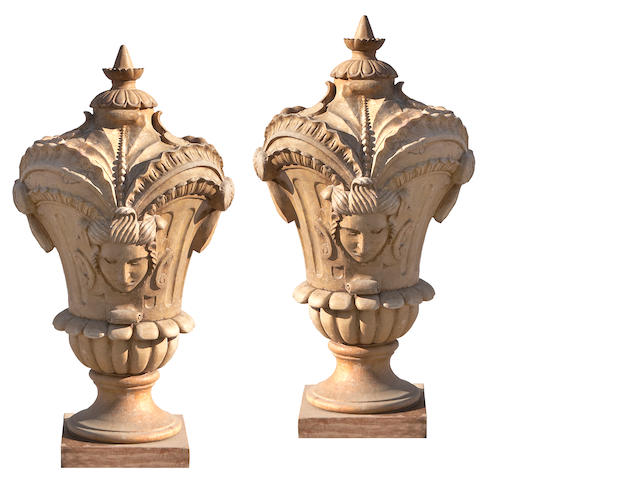 A pair of Rococo style buff and tan marble gate finials