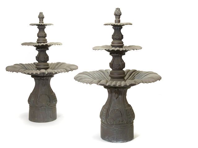 A pair of Victorian style patinated bronze fountains