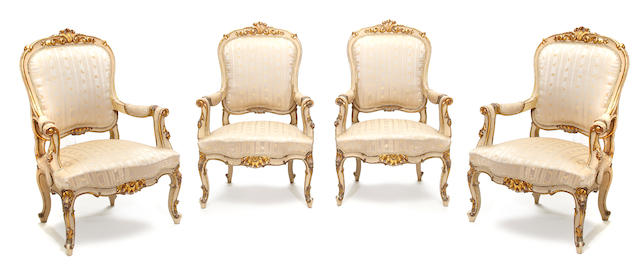 A set of four Italian Rococo style parcel and cream painted armchairs <BR /> fourth quarter 19th century