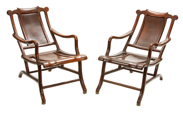 A pair of Chinese carved hardwood moongazing chairs