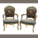 A pair of Rococo style needlepoint upholstered armchairs