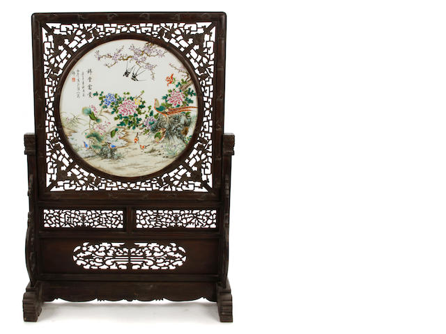 A large pair of polychrome porcelain and hardwood Chinese screens