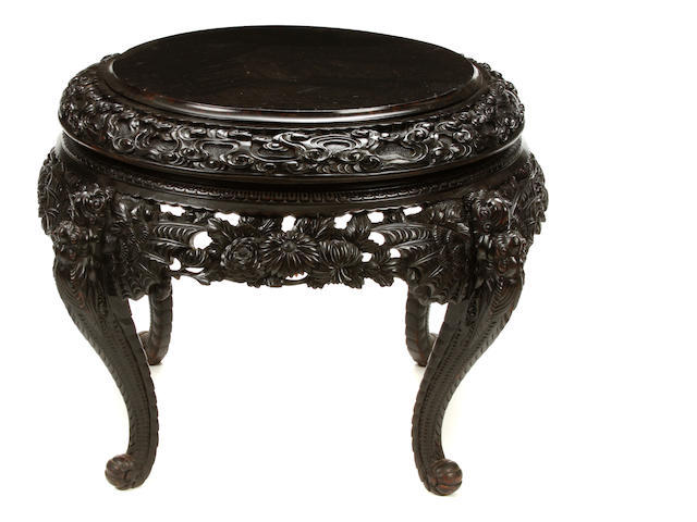 A large Chinese carved hardwood table
