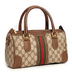 A Gucci monogram canvas and leather handbag
