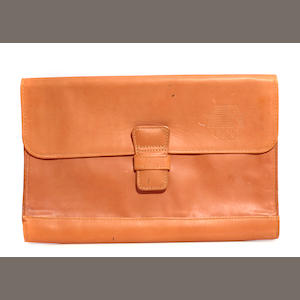 A tan leather document case commemorating the 1984 Olympic Games in Los Angeles