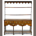 A George III oak high dresser <BR />fourth quarter 18th century