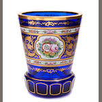 A Bohemian paint decorated blue glass cup