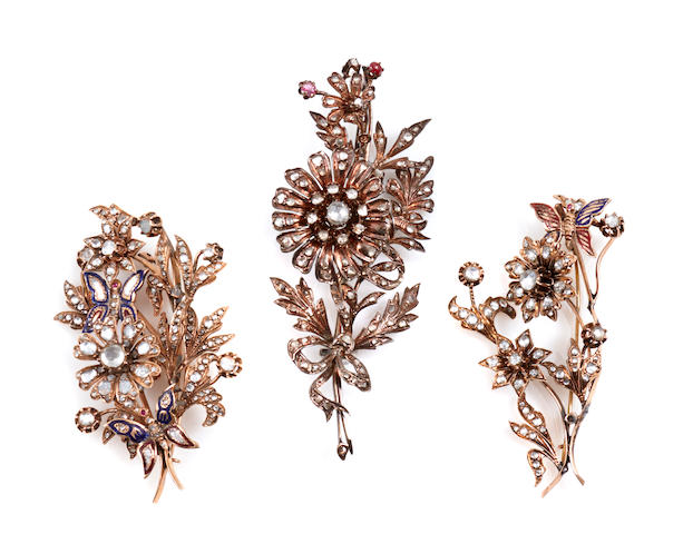 A group of three diamond, enamel and metal flower brooches