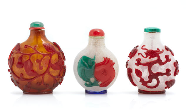 Three overlay Peking glass snuff bottles